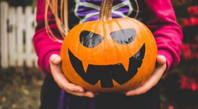 kid with pumpkin